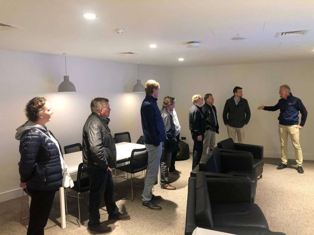 Raviurheilun Nuorisotoiminta & EMR executives are shown around the Curragh Racecourse by Racing Manager, Evan Arkwright.