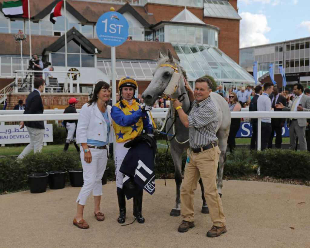 Jill Irwin with Poppstar (GB), Martin Dwyer and Anthony Holdsworth after winning the Emirates NBD Premier Handicap at DIAR Newbury in July 2019